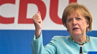 Germany's Merkel braces for poll defeat