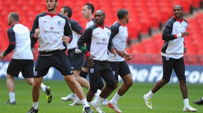 England team unite against racism in football