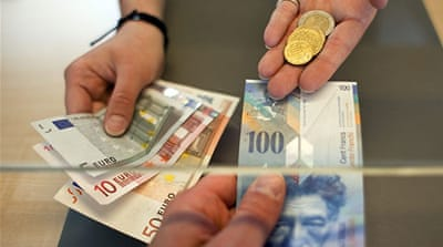 Markets stunned as Swiss peg franc to euro