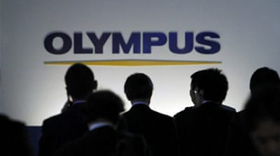 Olympus sues executives over cover-up