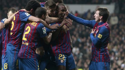 Abidal grabs winner for Barca against Real