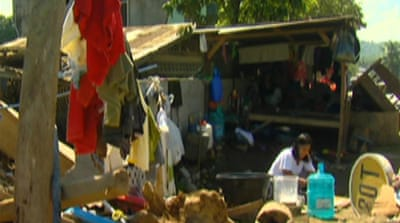 Philippine storm victims struggle on