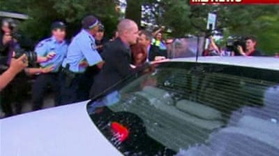Australia's Gillard dragged from protest