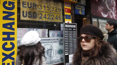 Eurozone debt doubts drag euro down