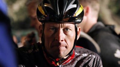 Bruyneel, left, was named in the US Anti-Doping Agency's report  as helping Armstrong organize doping. [AFP]