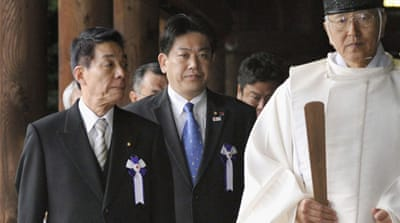 Japan's land minister (second from right) was among the visitors, as was Shinzo Abe, the opposition leader [Reuters]