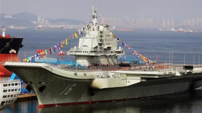 China lands jet on first aircraft carrier
