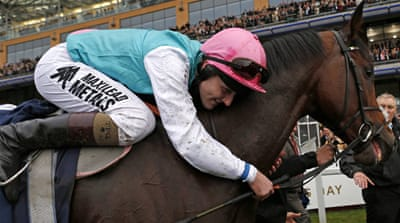 Jockey Tom Queally punched the air after winning, taking in the rousing reception from the crowd [Reuters]