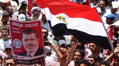"Whilst contextual and limited, the powers ""Morsi arrogated himself"" sound like they are ""open-ended"" [GALLO/GETTY]"