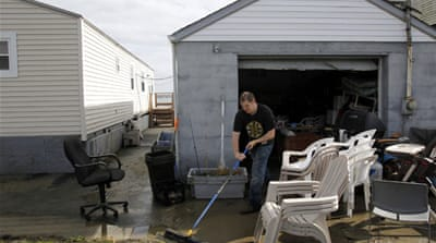 US clean-up begins after Sandy havoc