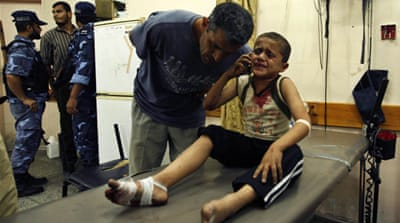 An Israeli tank fired at residents of Khan Younis, wounding four children and causing damage to buildings [Reuters]