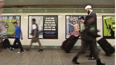 Egyptian-American activist Mona Eltahawy was arrested for attempting to cover an anti-Muslim ad in the subway [AP]