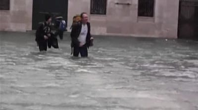 Venice submerged in near-record floods