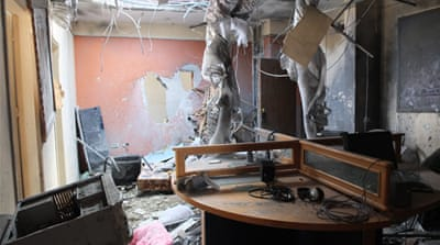 An al-Quds journalist was severely injured by a missile that struck this office as he slept [Nour Samaha/Al Jazeera]