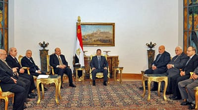 Egypt's Morsi stands by decree
