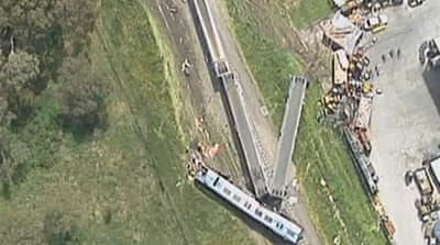 TV images of the crash showed crumpled train carriages lying smashed into each other across the tracks [Al Jazeera]
