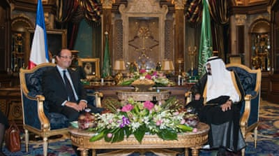 "Hollande told reporters his visit to Saudi Arabia aims at ""establishing a personal relationship"" with the monarch  [AFP]"