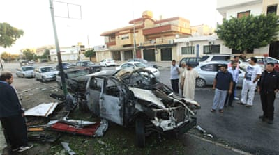 A car bomb exploded in front of the central Hadayeq police station in Benghazi, injuring three police officers [Reuters]