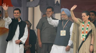 Prime Minister Manmohan Singh, left, and Congress leader Sonia Gandhi, right, both spoke at the rally [AFP]