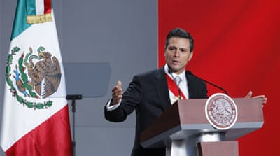 Mexican president sworn in amid protests