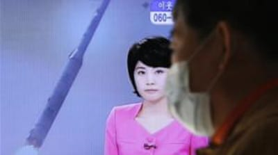 A North Korean TV presenter announced the successful launch of a long-range rocket on Wednesday [Reuters]