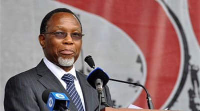 A native of Johannesburg's Alexandra township, Motlanthe, right, was once a member of the ANC's military wing  [Reuters]