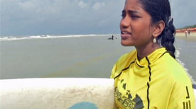 Girl defies surf customs in Bangladesh