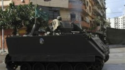 Lebanese army sent out patrols in the area separating Sunni and Alawite areas of Tripoli [Reuters]
