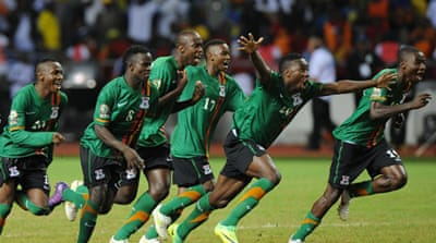 Zambia players gather in prayer following their 2012 triumph over the Ivory Coast [AFP]