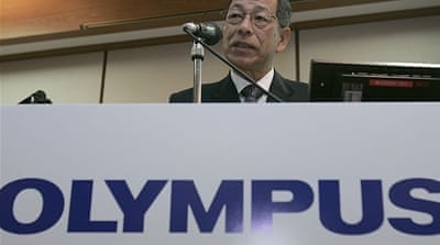 Ex-Olympus executives held in fraud probe