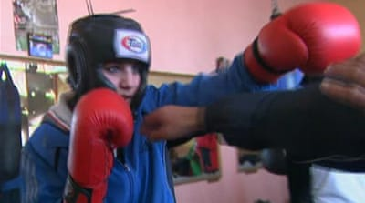 Afghan teen punches her way into Olympics