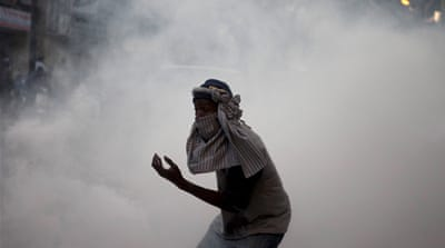 An anti-government protestor flees from tear gas at a protest in Senegal's capital Dakar, February 21, 2012. Hundreds of opposition supporters clashed with Senegalese security forces in the capital on Tuesday as European Union observers criticised a ban on protests and an African envoy jetted in to try and stem rising violence [REUTERS]