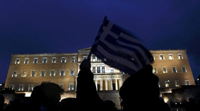 Fitch downgrades Greece on debt swap deal