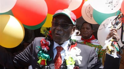Mugabe calls for early vote at birthday rally