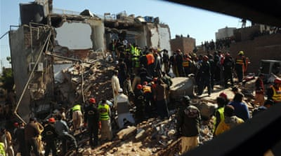 Dozens trapped in Pakistan building collapse