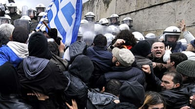 Greek workers strike over public job cuts