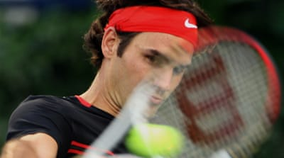 Federer express races into semifinals