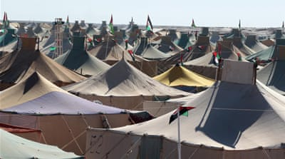 Many Sahrawi refugees live in tent camps in unforgiving stretches of the Sahara Desert [EPA]