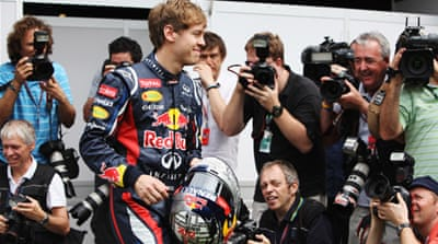 Vettel coy on hat-trick bid