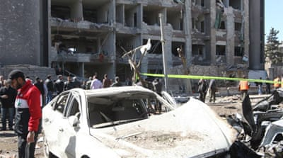 Twin car bombs kill dozens in Damascus