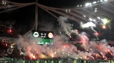 Fans and police clash in Athens' soccer derby
