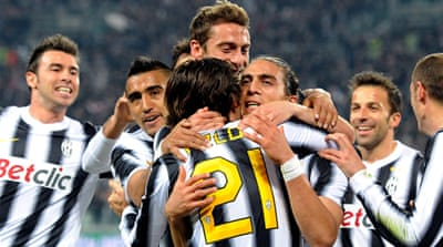 Juventus keep the heat on Milan