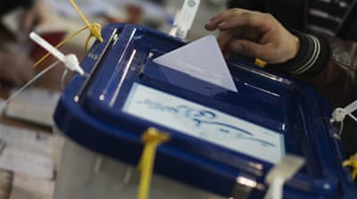 Iran reports high turnout in parliament vote