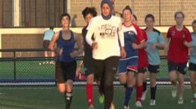 Football body votes to lift headscarf ban