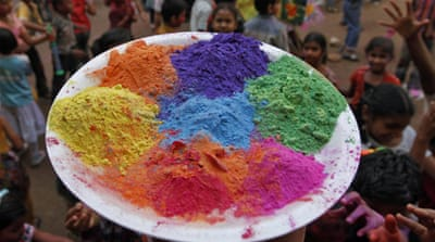India explodes with colour for Holi