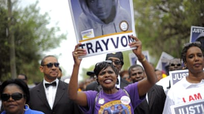 Thousands have joined the call for Trayvon Martin's killer to be arrested and for gun laws to be reformed [EPA]