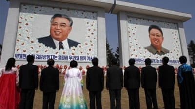 North Korean women attend a grand chorus event in Pyongyang to mark Kim Il-sung's 100th birthday [Reuters]