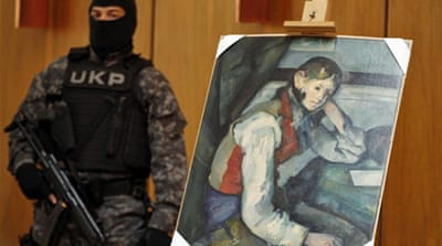 Serbian special police guarded the masterpiece in a news conference [Reuters]