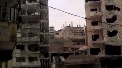 Syrian forces 'shell districts of Homs'