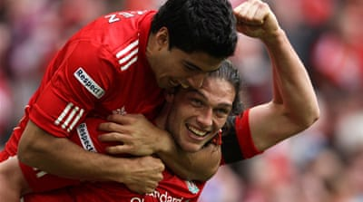 Carroll heads Liverpool to FA Cup final